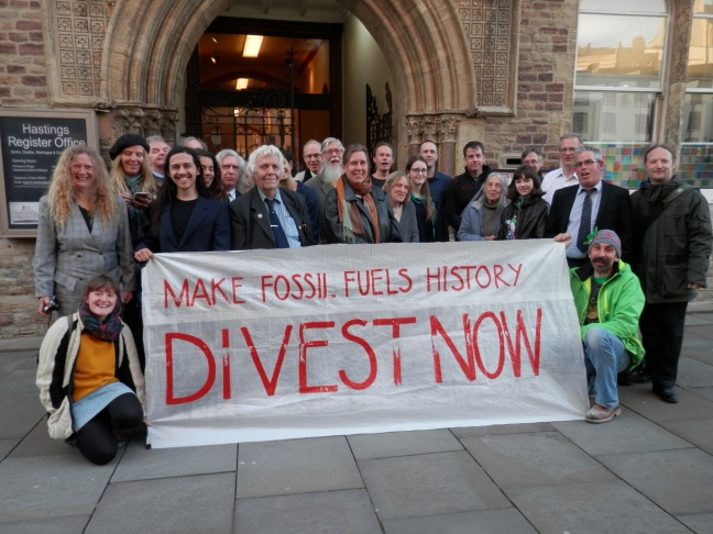 Campaigners celebrate Hastings Council's fossil fuel divestment vote outside Hastings Town Hall, 13 April 2016